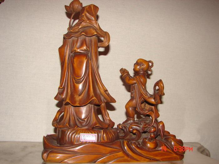 木雕童子拜观音
