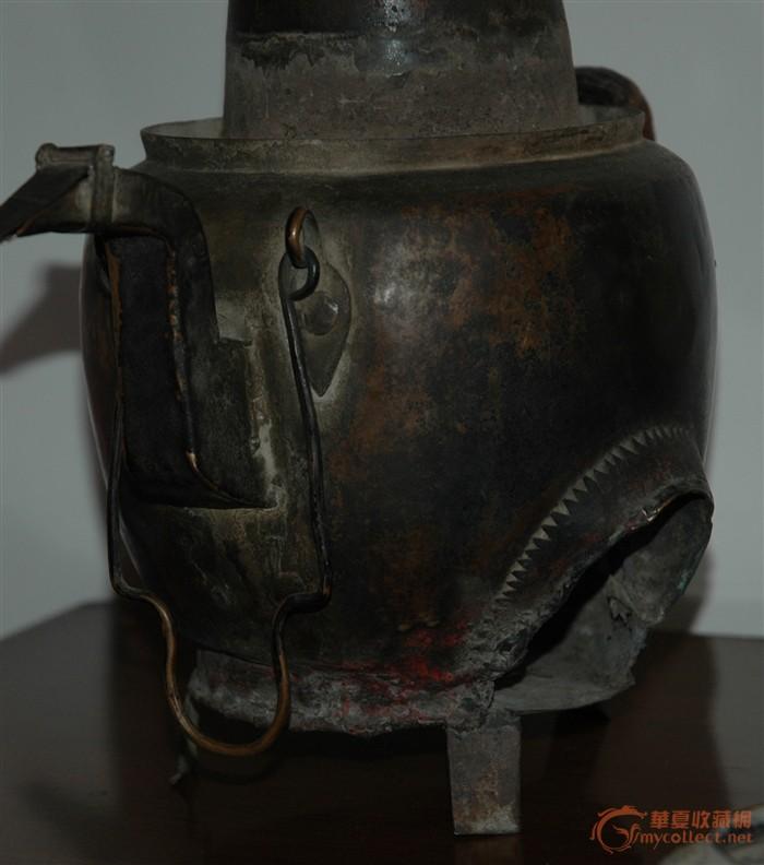 谁知道铜壶壶嘴前方用铜丝弯成的像提手似地东西是干