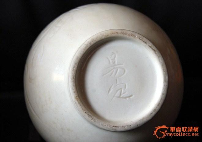 莲瓣纹是定窑器上最常见的划花纹饰.