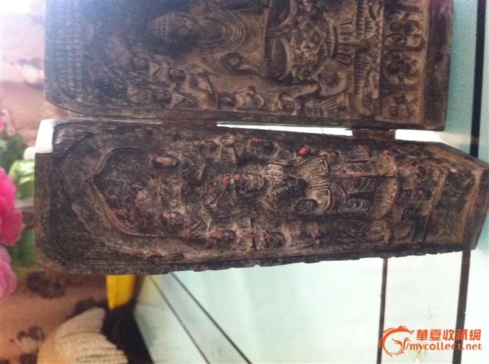 木雕圆柱体佛像