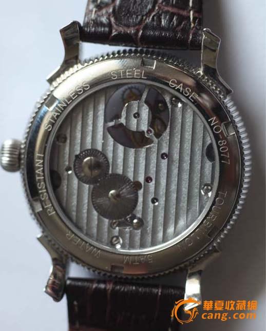 上传的均为陀飞轮手表,但海鸥牌的为无卡度中置陀飞轮,上海牌采用了