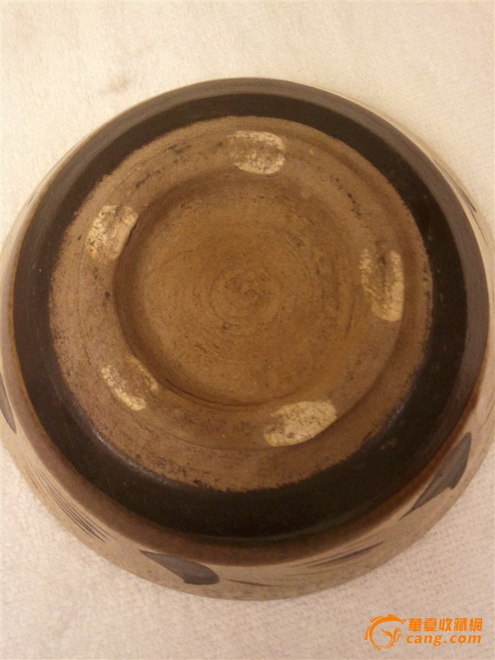 意见参考: 图片光线较暗,初看底足及工艺有金元时期磁州窑系特征,凭